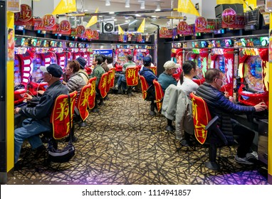 Tokyo, Japan, April the 14th, 2018. Players in a pachinko hall, Tokyo, Japan