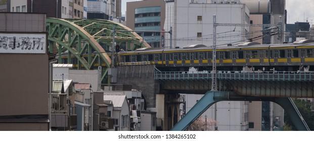 TOKYO, JAPAN - APRIL 16TH, 2019. Tokyo's commuter train at Ochanomizu multiple track station.