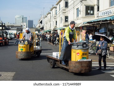 TOKYO, JAPAN - APRIL, 17, 2016: Unidentified man driving turret truck for transporting goods around the Tsukiji market. It is a large wholesale market for fish, fruits and vegetables in central Tokyo.