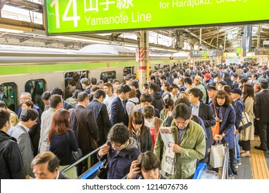 Tokyo, Japan - April 17, 2017: green line of Yamanote for Harajuku, the most important train line in Tokyo. Crowd of commuters waiting for rail train at Shinjuku Station in Tokyo.