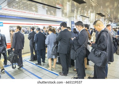 Tokyo, Japan - April 17, 2017: rush hour: crowd of people waiting the Marunouchi Line, subway line in Tokyo at Shinjuku Station. The Marunouchi Line is one of the most crowded railway lines in Tokyo.