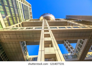 Tokyo, Japan - April 19, 2017: sprospective view of Fuji Television Building and Observatory in Odaiba, Minato district. Fuji TV headquarters is known for its bizarre and futuristic architecture.