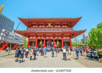 Tokyo, Japan - April 19, 2017: many tourists at south face of the Hozomon, Treasure-House Gate, entrance of Buddhist Temple Senso-ji, Asakusa, the oldest temple in Tokyo. Spring time, sunny day.