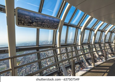 Tokyo, Japan - April 19, 2017: The spiral ramp of Tembo Gallery observation deck, the highest skywalk in the world. Tokyo skyline of Sumida district from Tokyo Skytree.