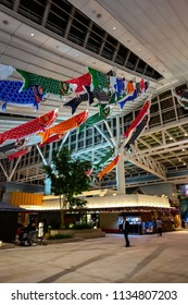 TOKYO, JAPAN - APRIL 19 2018: Koinobori  carp-shaped windsocks traditionally flown in Japan to celebrate Tango no sekku which is designated a Japanese Children's Day