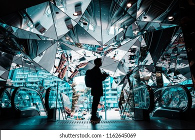 TOKYO, JAPAN - APRIL 19, 2018 : silhouette Male traveler at Omotesando Tokyo Plaza building in Harajuku, Tokyo, Japan. Tokyu Plaza is a fashion theme park shopping mall for the trendiest fashion.