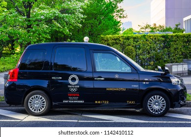 TOKYO, JAPAN - APRIL 20 2018: New model of Japanese Taxi called JPN Taxi prepares for Olympic 2020 tourism boom with accessible cabs and international drivers