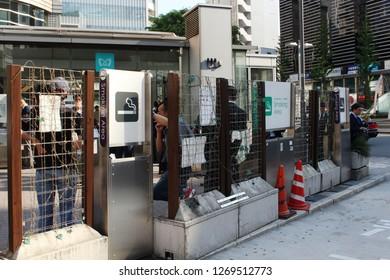 TOKYO, JAPAN - April 20, 2018: The back of a designated smoking area in Tokyo's Ebisu area.