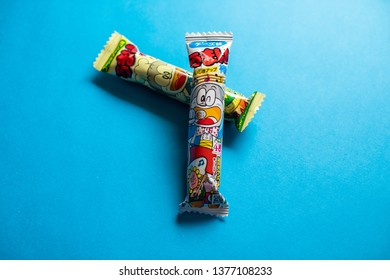 "Tokyo, Japan, April 20, 2019: Umaibo or ""delicious stick"" is a small, puffed, cylindrical corn snack from Japan. It is produced by Riska and sold by Yaokin. The mascot is a cat Umaemon."