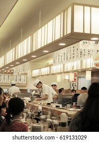 TOKYO, JAPAN - APRIL 20 : Sushi chef working in restaurant taken April 4, 2014 in Tokyo.