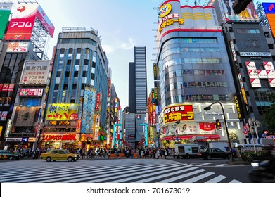 Tokyo, Japan, April 21, 2016: City street with crowd people on zebra crosswalk in Shinjuku town. Shinjuku is a special ward located in Tokyo for shopping and night sightseeing.