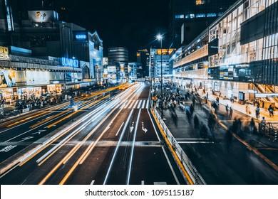 TOKYO, JAPAN - APRIL 21, 2018: Urban view with busy traffic around Shinjuku Station, Tokyo shot at night.