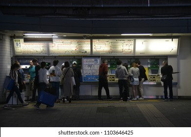Tokyo, JAPAN - April 21, 2018: Unknown Passengers Purchase The Train Ticket from Automatic Vending Machine at Harajuku JR Station Shibuya. The station is close to Takeshita Shopping Street.