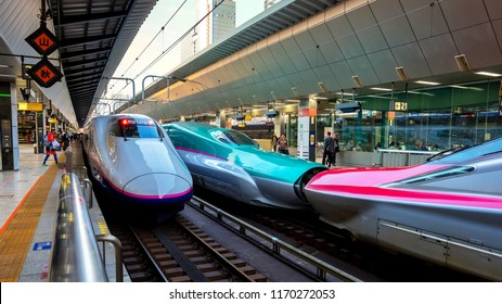 TOKYO, JAPAN - APRIL 21 2018: Japanese Shinkansen high speed train Hayabusa (left) and Komachi (right) join together travel up north east of Japan from Tokyo