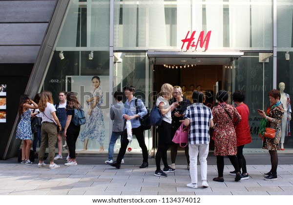 TOKYO, JAPAN - April 21, 2018: Visitors gathered in front the Ginza branch of the Swedish multinational clothing-retailer H&M.