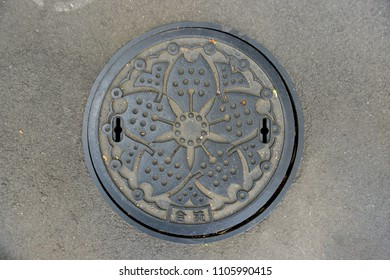 Tokyo, Japan - April 22, 2018: A beautiful design manhole cover in Tokyo is the picture of cherry blossom flower (Sakura)