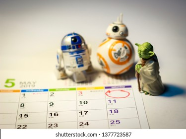 TOKYO, JAPAN - APRIL 22, 2019 - Star Wars Figures (Yoda, BB8 & R2-D2) on a calendar sheet looking at May the 4th, concept for Star Wars day