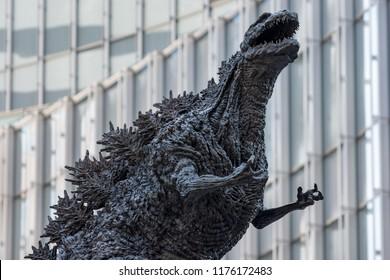 Tokyo / Japan - April 22nd 2018: New Godzilla statue at the Hibiya Godzilla Square in front of the revamped Hibiya Chanter building in Yurakucho, Chiyoda Ward in central Tokyo.