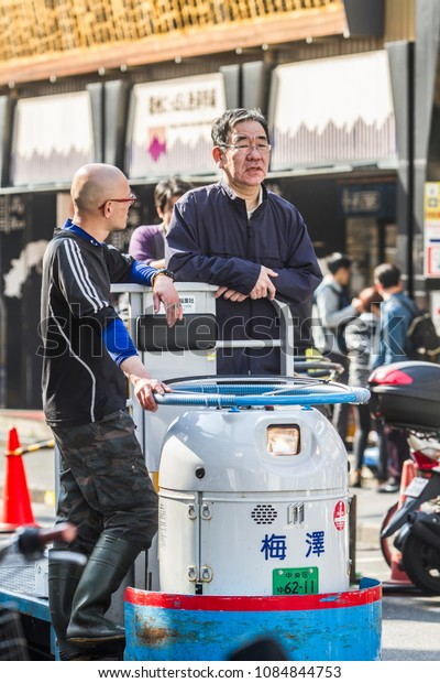 TOKYO, JAPAN - April, 24, 2018: A man driving taretto, motorized cargo cart, at Tsukiji, the biggest fish and seafood market in the world.