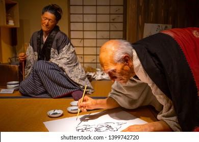 Tokyo, Japan - April 25, 2018: View of an animatronic figures of the Ukiyo-e artist (Japanese woodblock prints), Katsushika Hokusai and his daughter Oei at the Sumida Hokusai Museum