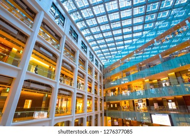 Tokyo, Japan - April 28 2018: Kitte Marunouchi Atrium is a huge triangular atrium: a courtyard space surrounded by six floors of stores inside Kitte Marunouchi building