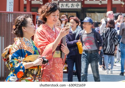 TOKYO, JAPAN - APRIL 29TH 2017. Tourists wearing colorful traditional rental kimonos at Sensoji Temple. Asakusa Tokyo. Asakusa is a popular destination for tourists.
