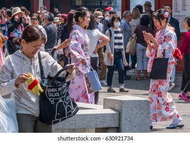 TOKYO, JAPAN - APRIL 29TH 2017. Tourists wearing colorful traditional rental kimonos at Sensoji Temple. Asakusa Tokyo. Asakusa is a popular destination for tourists.