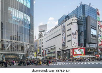 Tokyo, Japan - April 3, 2017: Pedestrians cross at Shibuya Crossing. It is one of the world's most famous and claim to be a busiest scramble crosswalks.