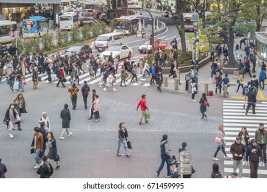 Tokyo, Japan - April 3, 2017: Pedestrians cross at Shibuya Crossing. It is one of the world's most famous and claims to be a busiest scramble crosswalks.