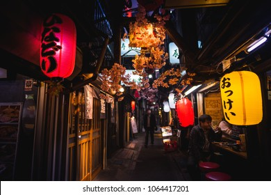 Tokyo, Japan - April 3 , 2018 : Famous place Japanese local steet food at Omoide Yokocho, Shinjuku tokyo in spring season , decorated with sakura cherry blossom very beautiful scene