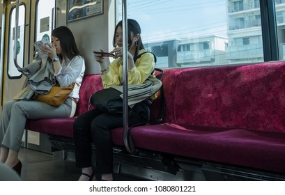 TOKYO, JAPAN - APRIL 30TH, 2018. Commuters looking at their smartphone in Japan Railway train.