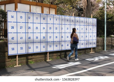 TOKYO, JAPAN - April 6, 2019: A large noticeboard in Aoyama with squares for posters of candidates standing in forthcoming local elections for the Minato Ward Assembly.