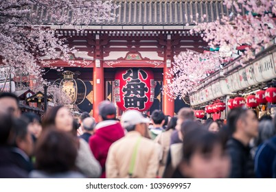 TOKYO, JAPAN - APRIL 7, 2017: Many people visit Nakamise-dori shopping street at Senso-ji Temple in Tokyo, Japan. Senso-ji is an ancient Buddhist temple located in Asakusa, Tokyo, Japan.