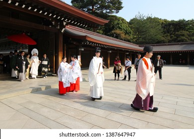 Tokyo, Japan - April 7, 2019: Procession ceremony of traditional Japanese wedding at Meiji, Shrine or Meiji Jingu, in Tokyo, Japan