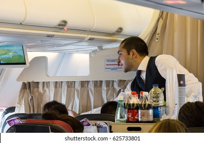 Tokyo, Japan - April 8th, 2017: Flight attendant serving breakfast onboard a Boeing 737, Turkish Airlines.