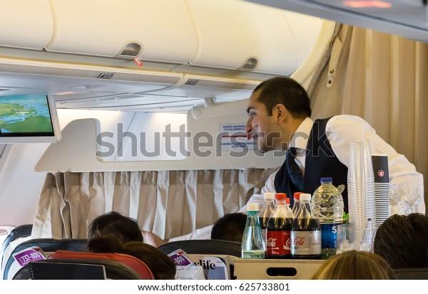 Tokyo, Japan - April 8th, 2017: Flight attendant serving breakfast onboard a Boeing 737, Turkish Airlines.