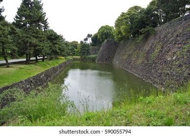 Tokyo, Japan - April 9, 2016: Stone walls and a moat of Edo castle ruins. Originally built in 1457. It is now part of Tokyo Imperial Palace. A historic site where shogun Tokugawa lived.
