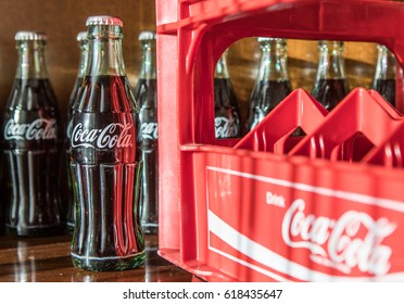 TOKYO, JAPAN - APRIL 9TH, 2017. Coca Cola original taste bottled drinks. The carbonated soft drink is produced by The Coca-Cola Company.