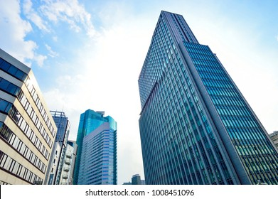 Tokyo, Japan - August 03, 2013: Tall building in Tokyo, background of blue sky