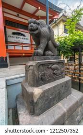 Tokyo, Japan - August 03, 2018 : Komainu (Lion-Dog) stone guardians at Bishamonten Zenkoku-ji Temple. located at Waseda-dori street, Kagurazaka district in Shinjuku Ward