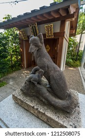 Tokyo, Japan - August 03, 2018 : Inari guardian Fox statue at Shusse Inari Jinja, Shinto Shrine located in the precincts of Akagi Jinja srine in Kagurazaka in Akagi -Motomachi district, Shinjuku Ward.