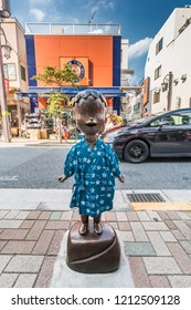 "Tokyo, Japan - August 03, 2018 : Cartoon Figure ""Kobo Chan"" created by Masashi Ueda Bronze sculpture by Asahiko Yamada. located at Waseda-dori of ""Geisha town"" Kagurazaka district in Shinjuku Ward"
