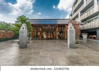 Tokyo, Japan - August 03, 2018 : Honden (Main Hall) of Akagi Jinja. Shinto srine renewed in 2010 by architect Kengo Kuma. Located in Kagurazaka in Akagi -Motomachi district, Shinjuku Ward.