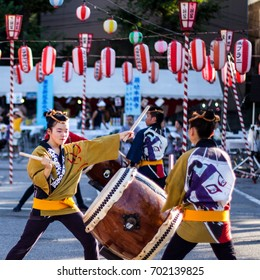 TOKYO, JAPAN - AUGUST 10 2012: Taiko drum performers from the Tsukiji Honganji Bon Odori Matsuri - the popular Bon Odori festival in Tokyo. Text on the lanterns are names of the festival sponsors.