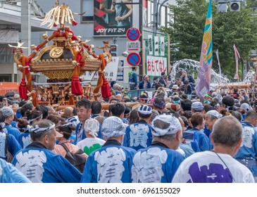 TOKYO, JAPAN - AUGUST 14TH, 2017. Participants carrying portable shrine locally known as mikoshi  at Fukagawa Hachiman Festival. The festival is held every 3 years.