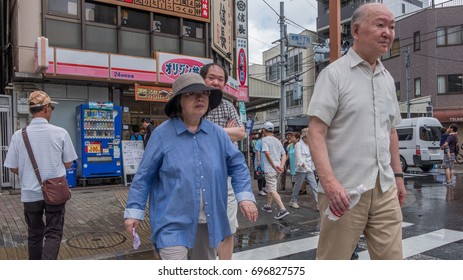 TOKYO, JAPAN - AUGUST 14TH, 2017. People walking in the streets of Tokyo.
