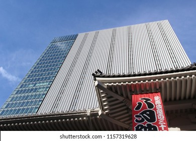 TOKYO, JAPAN - August 15, 2018: View of part of the traditional-style roof of Ginza's Kabuki-za kabuki theater with the Kabuzi-za Tower above it. This iconic building was designed by Kengo Kuma.