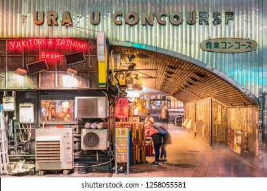 TOKYO, JAPAN - August 16 2018: Night view of the Yurakucho Concourse underpass under the railway line of the station Yurakucho. Japanese noodle stalls and sake bars revive the nostalgic years of Showa