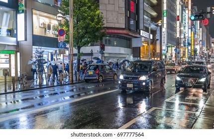 TOKYO, JAPAN - AUGUST 16TH, 2017. Shinjuku street night view after rain.