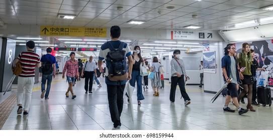 TOKYO, JAPAN - AUGUST 16TH, 2017. Commuters navigating their way through  Shinjuku train station